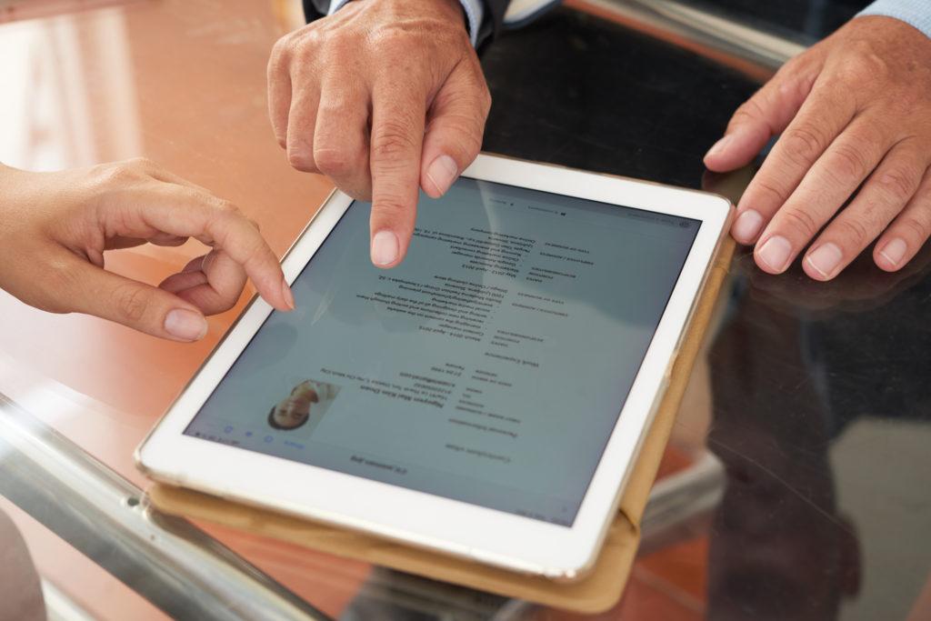 man scrolling on ipad | digital marketing video marketing | field1post.com